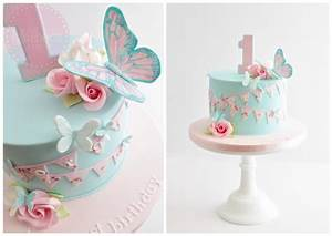 Butterflies, flowers and bunting birthday cake for a ...