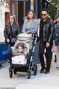 John Legend and Chrissy Teigen look devoted as they walk ...