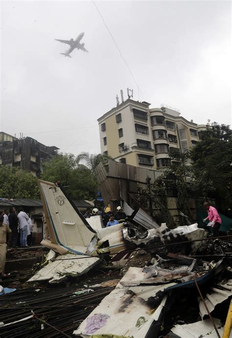 private plane crashes  crowded mumbai area  people dead  seattle times