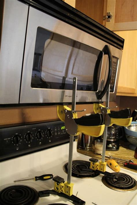 hang microwave without cabinet above how to install an over the range microwave jackcl