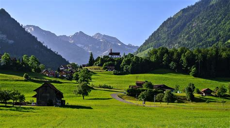 Switzerland town countryside landscapes houses trees grass
