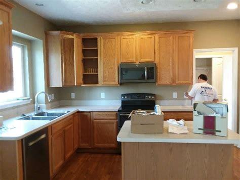 glossy white paint  honey oak kitchen cabinets