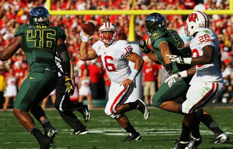 russell wilson pictures rose bowl game presented