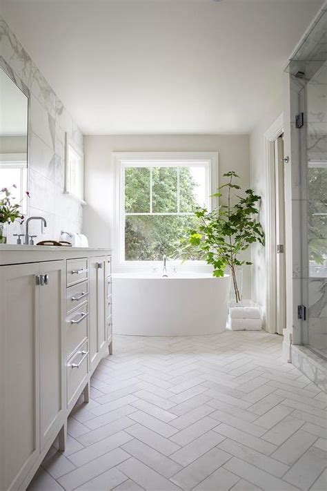 white shiplap bathroom  gray slate herringbone floor