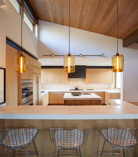 kitchen island pendant lighting emits golden glow  sun