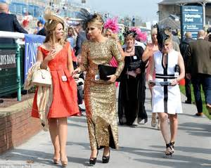 gold wedding guest dress colourful headgear and bold take centre stage as day at doncaster gets underway