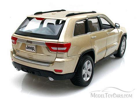 toy jeep cherokee jeep grand cherokee laredo gold maisto 34205 1 24