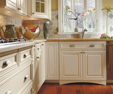 off white cabinets with brown glaze off white cabinets with glaze omega cabinetry