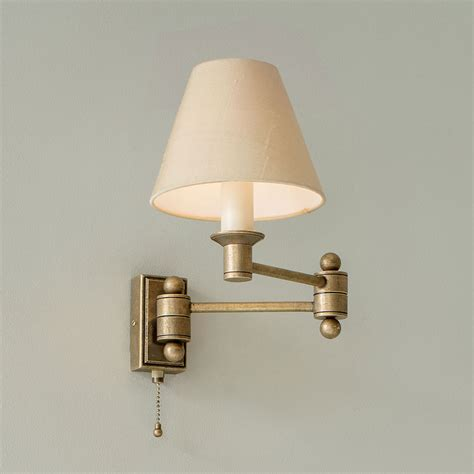 brass adjustable wall light elegant hinged arm wall