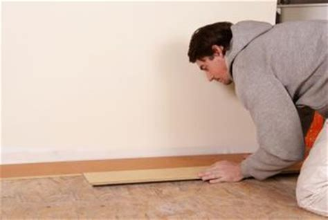 How to Trim Wood Baseboard While Installed on the Wall