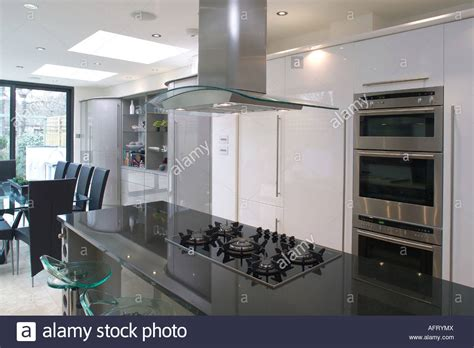 island extractor fans for kitchens extractor fan above hob in black granite island unit in modern stock photo royalty free image