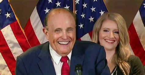 rudy giuliani busts  laughing  reporter  cnn