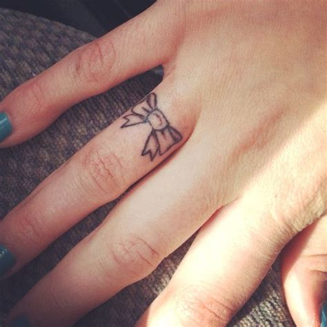 bow tattoos  fingers