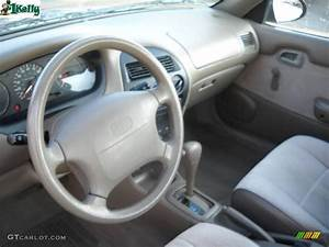 Beige Interior 1995 Geo Prizm Standard Prizm Model Photo