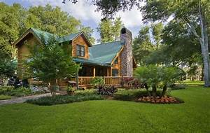 Photos of a custom log home in rural florida for Log home landscaping ideas