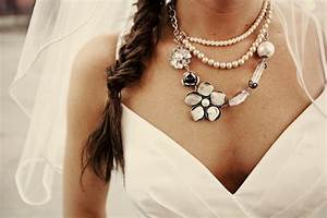Bohemian bride wears v neck wedding dress statement for Wedding dress necklace