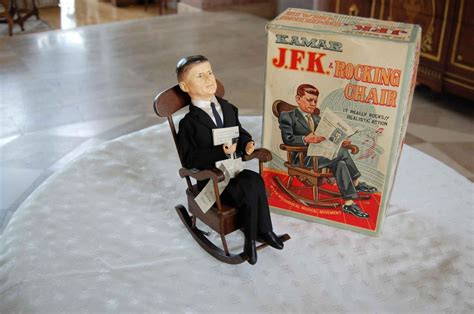jfk in rocking chair wind up toy