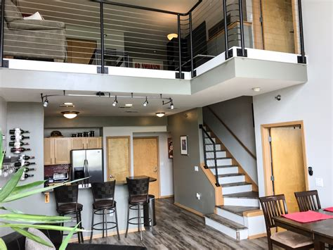 fully furnished  bedroom modern loft style condo