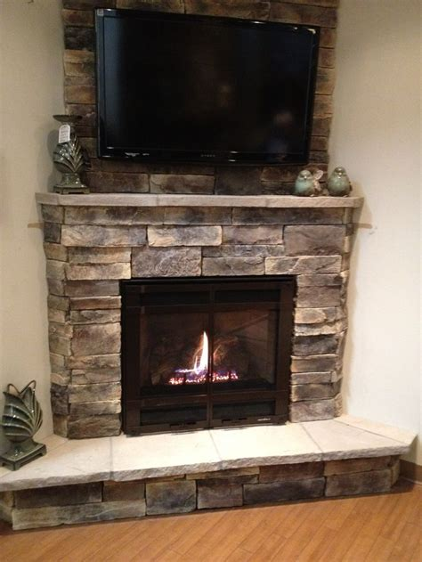 corner fireplace  tv mounted  fireplaces