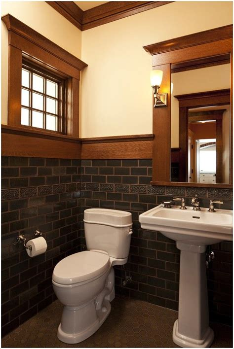wood framed arched mirror tile tile accents tile floor wall sconce wood cas craftsman style