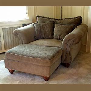Grabbing, A, Big, Chair, With, Ottoman, To, Relax, After, A, Long, Day