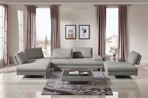 That's because the coffee tables here are in various shapes and dimensions. Divani Casa Baxter Modern Grey Fabric Sectional Sofa & Coffee Table Set
