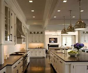 black granite countertops a daring touch of With the perfect kitchens with white cabinets for you