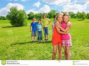 Girls Standing In The Park Hugging Stock Image - Image of ...