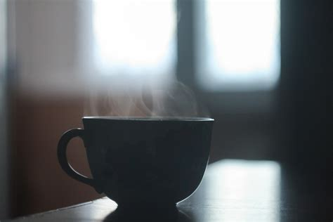 black ceramic cup  smoke   stock photo