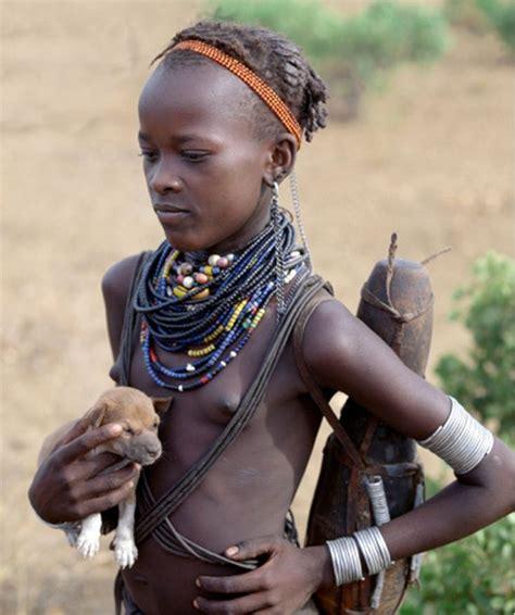 Girl Tribe Africa Dassanech Girl Holding A Puppy Omo Valley