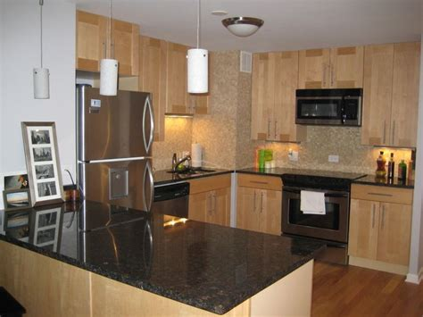 maple cabinets black granite countertop subway