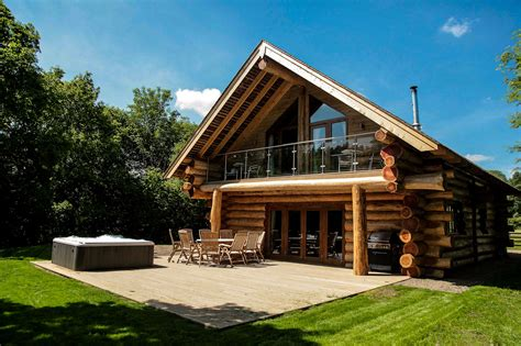 lake windermere log cabins with tubs river cabins carlisle