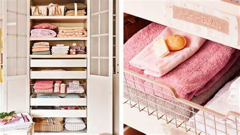como guardar  ordenar las toallas  sabanas