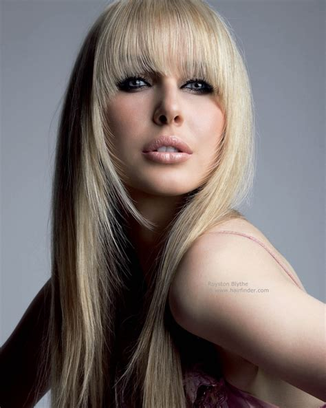 long straight hairstyle featuring a heavy fringe and face