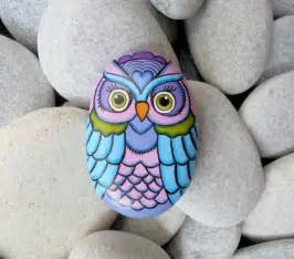 Colorful Painted Owls On Rocks