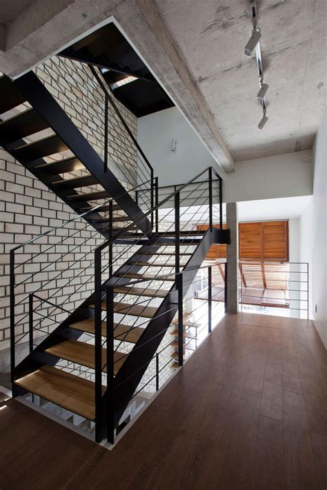 Foldable Stairs Industrial Designer by Townhouse With A Folding Up Shutter By Mm Architects