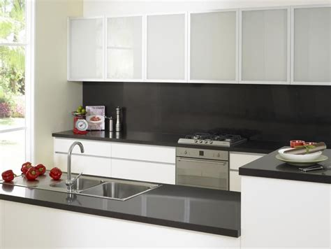 black bench top and splash with frosted overhead cupboards
