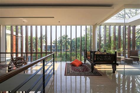 wooden slats glass walls  modern grandeur gallery house  india