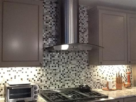 a custom backsplash designed to match cambria s praa sands