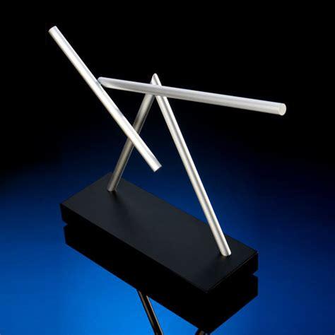 swinging sticks kinetic desk sculpture  green head