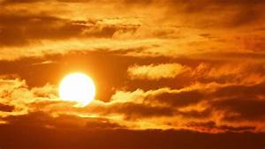 4K. Beautiful Scenic Sunset Sun Moving Across Fiery Red ...