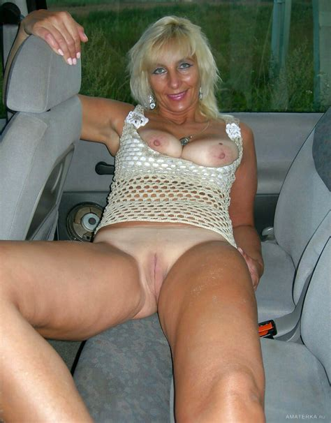 Mature Showing Off Her Tanlines In The Back Seat Porn Pic