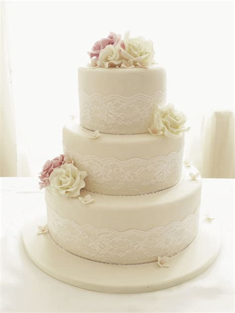 Round Wedding Cakes Ivory Roses And Lace Three Tier