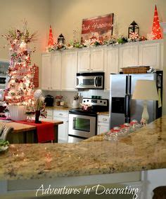 garland for above kitchen cabinets decorating above kitchen cabinets winter 6791