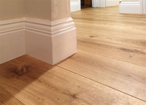 Fitting wood flooring under skirting boards   Fine Oak