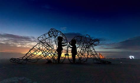large wire frame sculpture shows  glowing forms