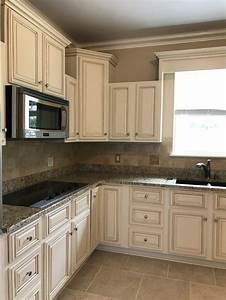 Creamy off white painted kitchen cabinets with brown glaze for Kitchen colors with white cabinets with off sticker