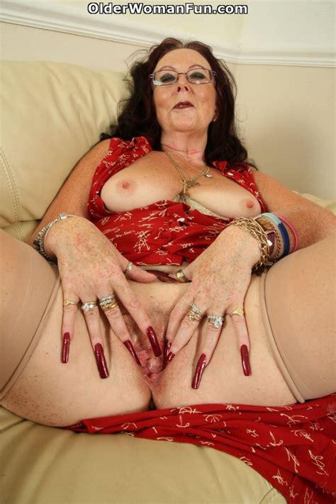 62 Year Old British Granny Zadi Fucks Herself Photo Album