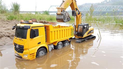 excavators work the river dump truck for