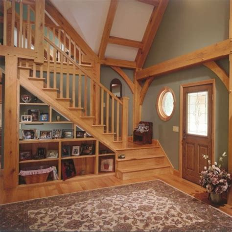 Decorating Ideas For Living Room With Stairs by 15 Living Room Stairs Storage Ideas Shelterness